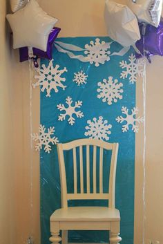 Photo Booth – Use silver vanity chair with a cotton ball garland for snowflakes with blue paper or plastic table cloth background