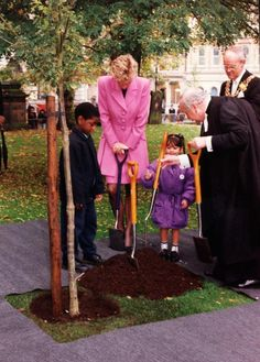 October 12, 1993: Princess Diana with two children from St. Thomas's Church of England School and the Lord Mayor, Paul Tilsley and clergy from St. Phillip's Cathedral Birmingham City Centre, Birmingham.