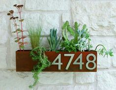 thin metal planter house number box with rust patina