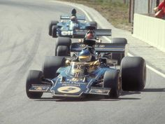 1972, Ronnie Peterson ahead of Emerson Fittipaldi, both in Lotus 72s, behind them is Jackie Stewart in a Tyrrell.