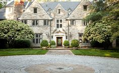 CURB APPEAL – outstanding stone home with a round-about driveway.