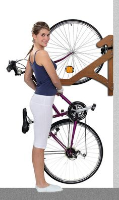 Elegant and Space-saving Wooden Bike Racks by Ergo Bike Racks. Get your bicycle off the floor and out of the way with these wall-mounted bike racks for apartments. They are not only sculptural but practical. The easy-to-use no-lift design allows you to hang your bicycle in style by gently pushing the front wheel into the rack.