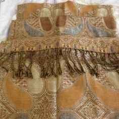 Scarf with metallic undertones Really pretty scarf with gold and silver undertones, the ends have fringes. The scarf is really soft against the skin. Accessories Scarves & Wraps