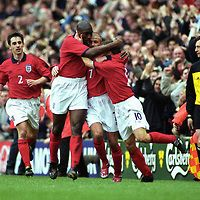 Football - World Cup Qualifier , Group 9 , England v Finland , Anfield , 24/3/01.England's David Beckham celebarates scoring with Sol Campbell , Michael Owen and Gary Neville.©JUHA TAMMINEN