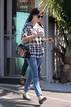 Dakota Johnson wearing Gucci Gg0050 Sunglasses, Dieppa Restrepo Two Tone Penny Loafers, Gucci Cruise 2018 Dragon Bag, Re/done Jeans and Theory Checked Blouse getting coffee on October 9, 2017.