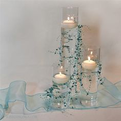 Floral Wedding Centerpieces Planning and Tips - Love It All Floating Candle Centerpieces, Unique Centerpieces, Wedding Table Centerpieces, Flower Centerpieces, Wedding Decorations, Centerpiece Ideas, Hanging Candles, Turquoise Centerpieces, Pearl Centerpiece