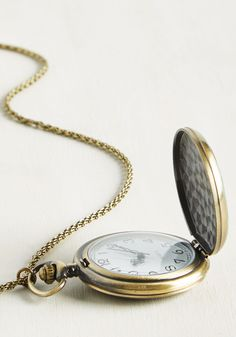 Weather De-Pendant Necklace. If it rains today, the blue enamel painted on this pocket watch necklaces pendant will coordinate chicly with the cool drops. #green #modcloth