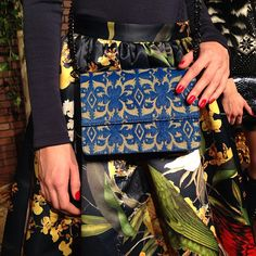 Pattern mixing with red hot nails. #NYFW @alice + olivia #Fall2013....I need this clutch