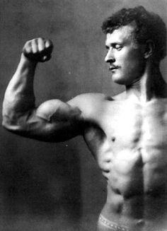 The First Celebrated Bodybuilder: Eugen Sandow flexes.