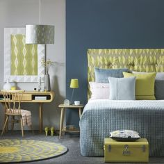 Blue and grey bedroom with yellow and white accents