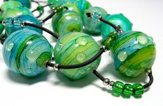 Faux lampwork with polymer clay, alcohol inks, and liquid clay. Detail am Nachmittag by ilex123, via Flickr