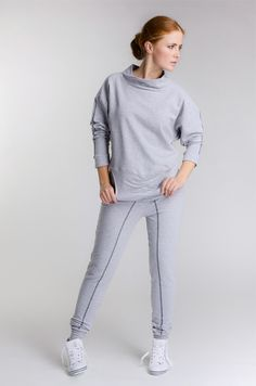 Comfortable cotton tracksuit for every day wear: a loose fitting top with a wide polo neck and narrow bottoms for a slimmer look.   Ideal for long or ankle boots but also high heels, when we want to look smarter. Decorative dark grey insets in the sleeves and legs.   Fabric composition: 96% cotton, 4% elastane.