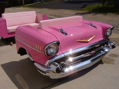 I know this is suppose to be a Man Cave, but how awesome is this pink 1957 Chevy Full Car Diner Booth?!?!?!?!?
