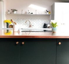 Copper Kitchen worktop paired with beautiful muted tones to really make the worktop shine!