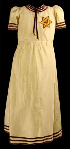 The owner of this dress, 13-year-old Tauba Szmukler, was deported with her mother from the Drancy camp in France on February 11, 1943. She died in the Auschwitz killing center in occupied Poland.