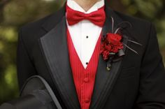 Groom and groomsmen outfit! Bow tie is cute, though the top hat can go. I love the boutonniere!