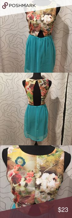 """Anthropologie dress by Cotton Candy Colorful dress by Cotton Candy , floral top, bright teal skirt, cutout front and open back, back zip,lined.Length 31.5"""", waist 14"""",chest 17"""" Anthropologie Dresses Midi"""