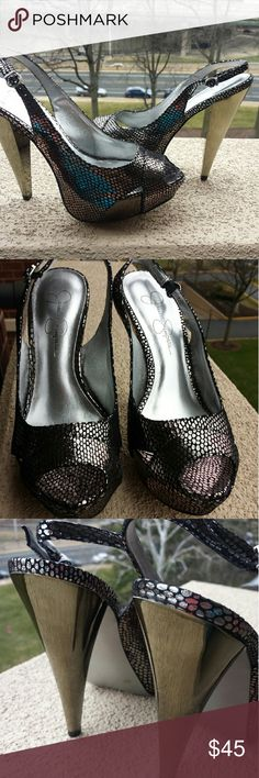 Iridescent Jessica Simpson platform shoes Platform slingback with iridescent upper and silvery metallic heel and platform.  Platform about 1 inch and heel between 4-5 inches. Never worn,  mint condition. Jessica Simpson Shoes Heels