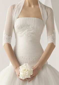 I've never been the type who wanted a shrug or anything OVER my wedding dress....but this is kind of pretty....
