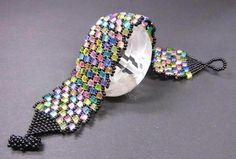 *_UNIKAT_*  Dieses fröhlich-Bunte Armband habe ich aus böhmischen, schwarzen Glasrocailles und bunten Preciosa Glaswürfeln mit Silbereinzug gefädelt. Der Knebelverschluß ist ebenfalls...