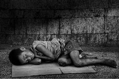 Cebu City, Phillippines.  The street children usually sleep in groups unless, like this one, they have been rejected by the group.