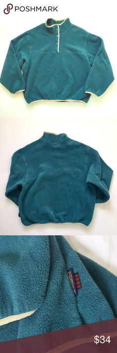 Woolrich // Snap Neck Fleece Pullover Like New! Women's snap neck fleece pullover by Woolrich. Soft, dark teal fleece with contrasting light green trim. Mid-weight fleece is perfect for layering on cold days or as a light jacket. No stains or imperfections. 🚫trades🚫 smoke free home Woolrich Sweaters