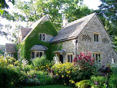 The oldest building in Greenfield Village was imported from England's Cotswold Hills.  It is surrounded by a lush country garden.