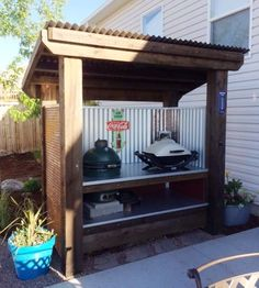 BBQ Shelter made with corrugated metal. Gusty winds won't interfere with your barbecue any longer.