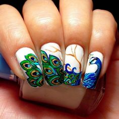 """Just check out the best and amazing looking """"Peacock Nails Designs"""" right from this post! We are sure all the crazy fans of nail art designs will like these . Fancy Nails, Love Nails, Pretty Nails, My Nails, Easy Nail Art, Cool Nail Art, Nails Ideias, Peacock Nail Art, Peacock Design"""