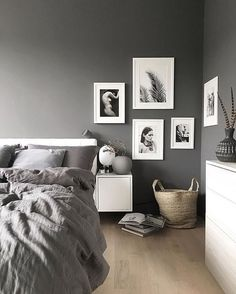 Bedroom with grey walls + black & white art