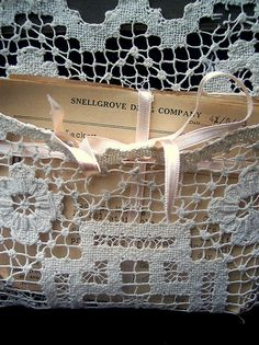 Lace.... cute idea for holding lightweight paper craft supplies.