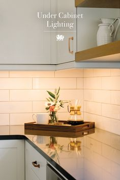 When renovating a kitchen, don't forget that a well-lit countertop can be the best accessory. Under-cabinet lighting makes all the difference in even the coziest of corners. [Featured Design: Fieldstone™]