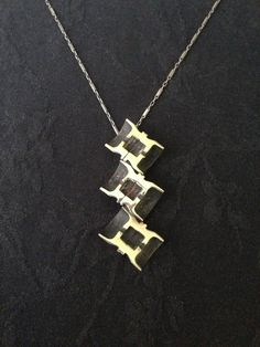 Sliced and Stacked Bullet Necklace by ginamount on Etsy