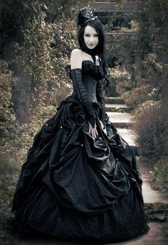 A woman wearing a wearing black satin dress on her way to the Gothic Ball