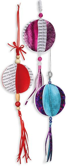 Experiment with papers by cutting two-dimensional symmetrical shapes to create these eye-catching bauble decorations.