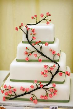 Japanese Cherry Blossom Wedding Cake + the desired kokeshi figurines = me happy XD