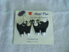 """Handpainted Porcelain Cat Earrings from Appl Pye Surgical Steel French Wire Hooks Pre-owned but never worn. 2"""" from top of hook. International Buyers - Please Note: Import duties, taxes, and charges are not included in the item price or  shipping cost. These charges are the buyer's responsibility. Please check with your country's customs office to determine what these  additional costs will be prior to bidding or buying. 