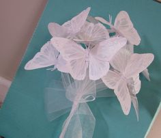 Butterfly Wedding Bouquet in White by GardenLeafDesign on Etsy...I would just one of these butterflies to add to my bouquet.