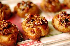 Ina Garten's Easy Sticky Buns - from Barefoot Contessa Back to Basics  12 tbsp. (1 & 1/2 sticks) unsalted butter, room temp; 1 c. light brown sugar; 1/2 c. pecans; 1 pkg (17.3 oz.s/2 sheets) Pepperidge Farm frozen puff pastry; 2 tbsp. unsalted butter; 3 tsp cinnamon; 1 c. raisins