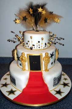 Come to the Oscars with this simple but yet creative cake! Perfect for a movie themed party and or preperation to the Oscars! Feel like you're on the red carpet with this beautiful creation.