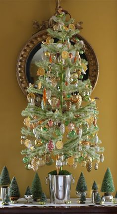 perfectly decorated feather tree http://reggiedarling.blogspot.com/2011/12/oh-christmas-tree.html