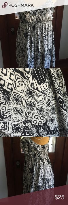 Torrid Sz 2 black and white skull dress Super cute only worn twice! Great light fabric with adjustable straps! Skulls are hidden and some people don't even notice them! torrid Dresses