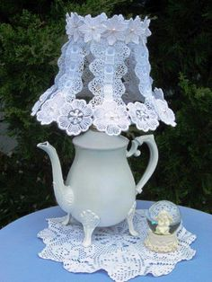 lampshade turned stunning with motifs of lace flowers sewn on to the frame... old kettle was painted white