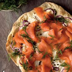 I have never put smoked salmon on pizza!  wonderful taste with the cream cheese and dill and capers...don't mess with the homemade crust