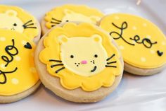 Want to make them?  You'll need:    circle cookies   royal icing in AmeriColor Egg Yellow, Lemon Yellow, Deep Pink and Super Black   decorating tips in #1 and #2   disposable icing bags   toothpicks   squeeze bottles    AmeriColor Gourmet Writer, black   a baby named Leo ♥
