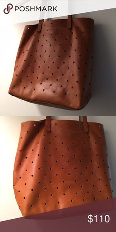 Madewell Hole Punch Tote Sold out- camel brown color. Great condition, used for one year. Small pen mark on exterior. See photo. Amazing tote for travel or everyday. Madewell Bags Totes