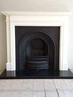 Excellent Photos white Fireplace Hearth Popular Installation of a Crown cast iron insert with a Limestone mantel and granite hearth. Fireplace Hearth Stone, Cast Iron Fireplace Insert, Candles In Fireplace, Small Fireplace, White Fireplace, Fireplace Inserts, Living Room With Fireplace, Fireplace Surrounds, Fireplace Mantels