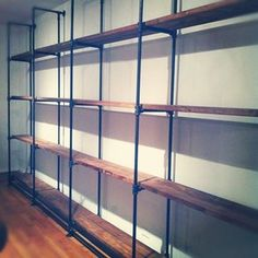 Custom-Sized Industrial Pipe And Reclaimed Wood Shelving custom made by J Reclaimed Wood Custom Furniture