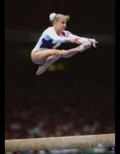 Graceful Shannon Miller... i wish my wolf jump on beam looked like that!!