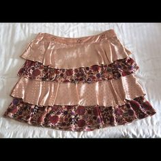 Fun & Flirty Tiered Miniskirt Alternating satin and floral knit tiers, small metal studs at waistband.  By Muchacha, high-end brand from Spain.  Listed as Free People for visibility and similar style.  New without tags. Free People Dresses